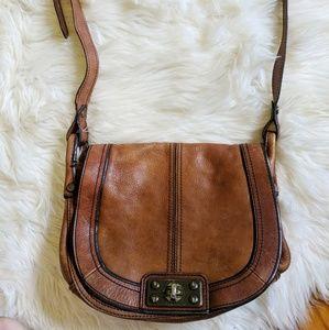 Fossil brown leather kiss lock saddle bag